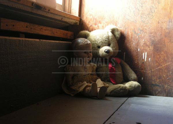 Discarded Bear & Doll by Lollie Ortiz