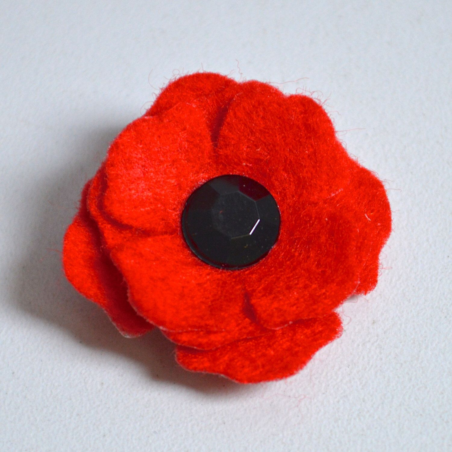 small red poppy lapel pin brooch with glass button centre