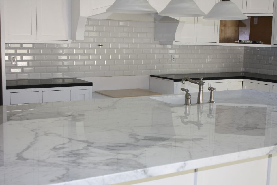 Calacatta Gold Island Slab And Beveled 3x6 White