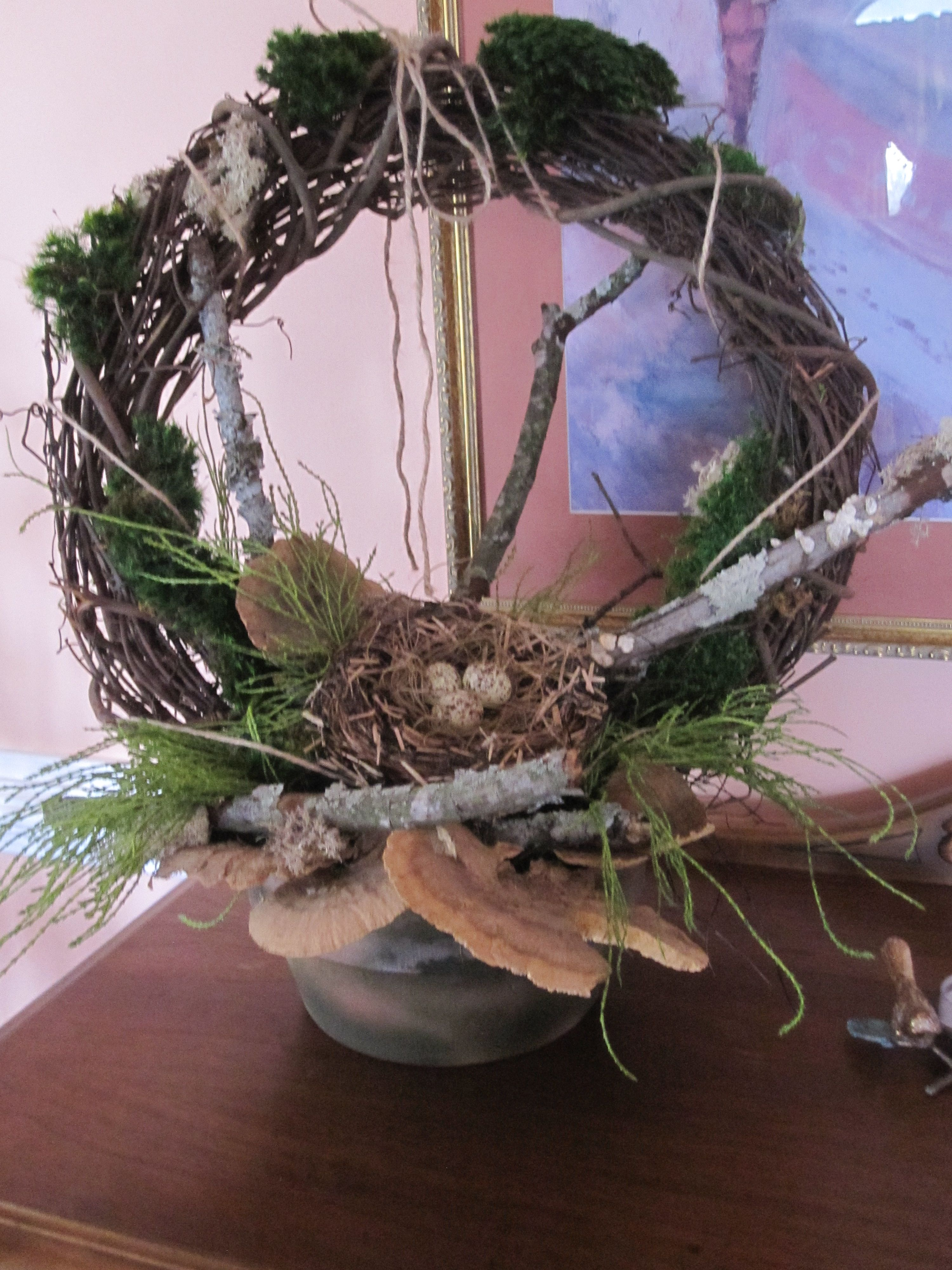 Inspired by bird nests found during late winter pruning. Created by Christine's Creations of Woodstock, GA.