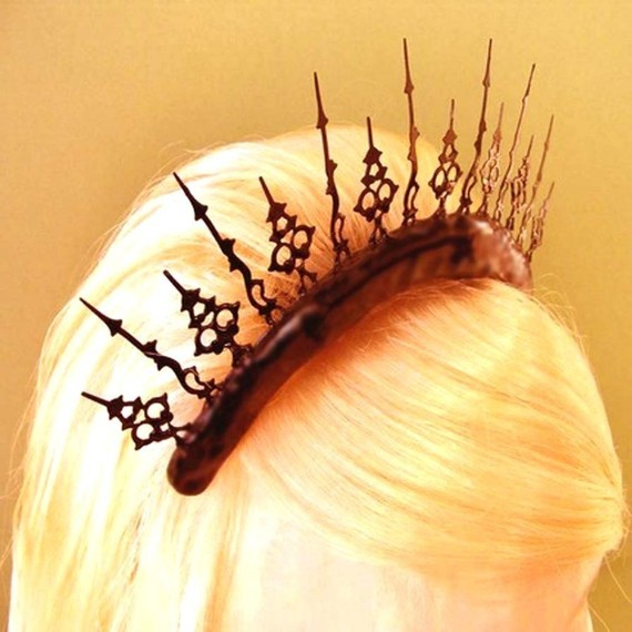 Be it adventure, romance, or just on the prowl this tiara is the perfect accent for any hair do. Made out of small ornate clock hands it adds just a little of Gothic, Neo-Victorian sparkle to any outfit. This is the hair accessory that will bring excitement and adventure to you. A tiara with echos of the past encased in it's clock hand peaks.    The tiara measures about 7 inches wide and 2 1/2 inches high, at the tallest point. It is very durable, so you may dance and prowl to your hearts…