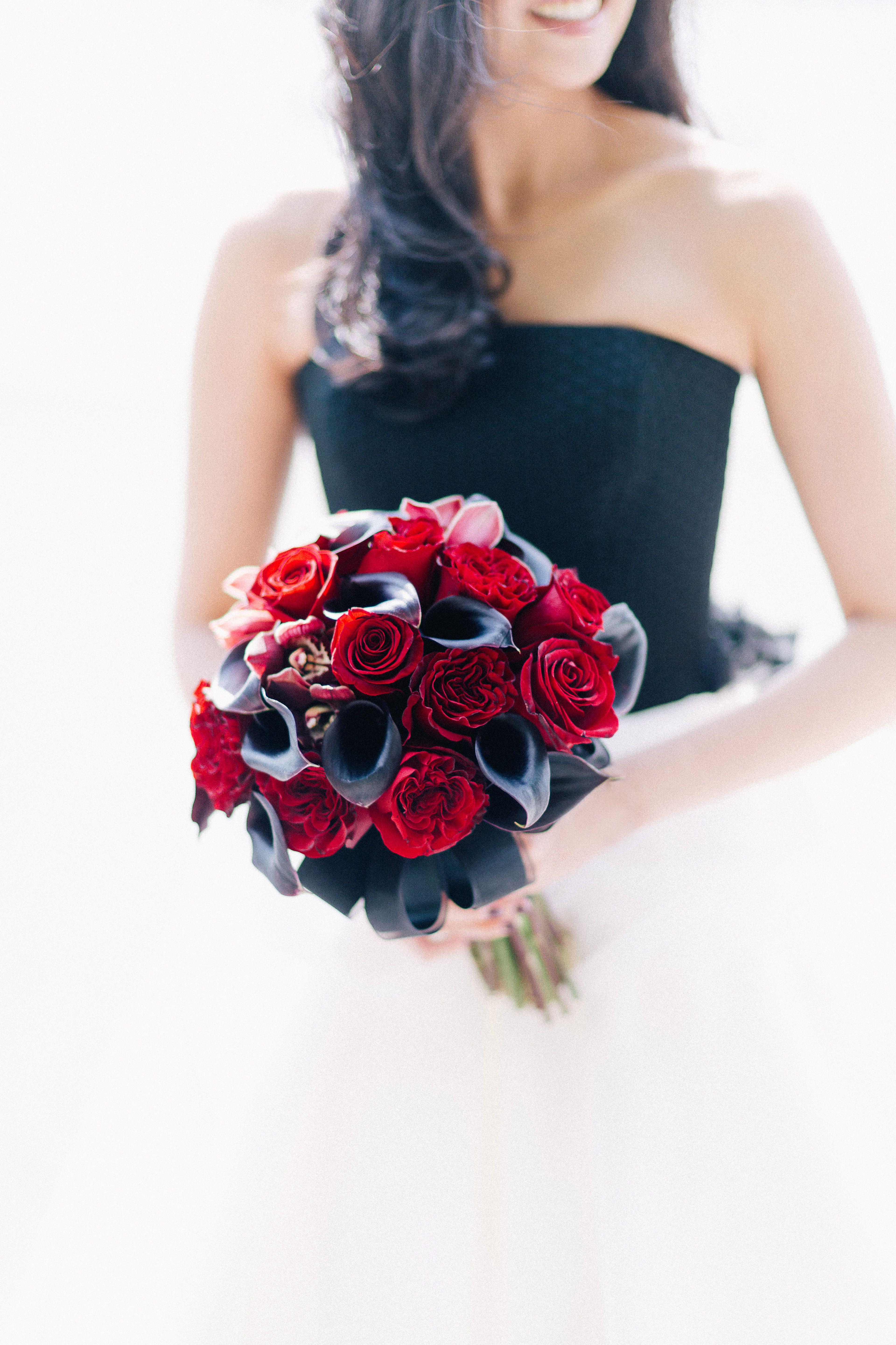 Roses Orchids And Calla Lilies In An Array Of Red Tones Were Used