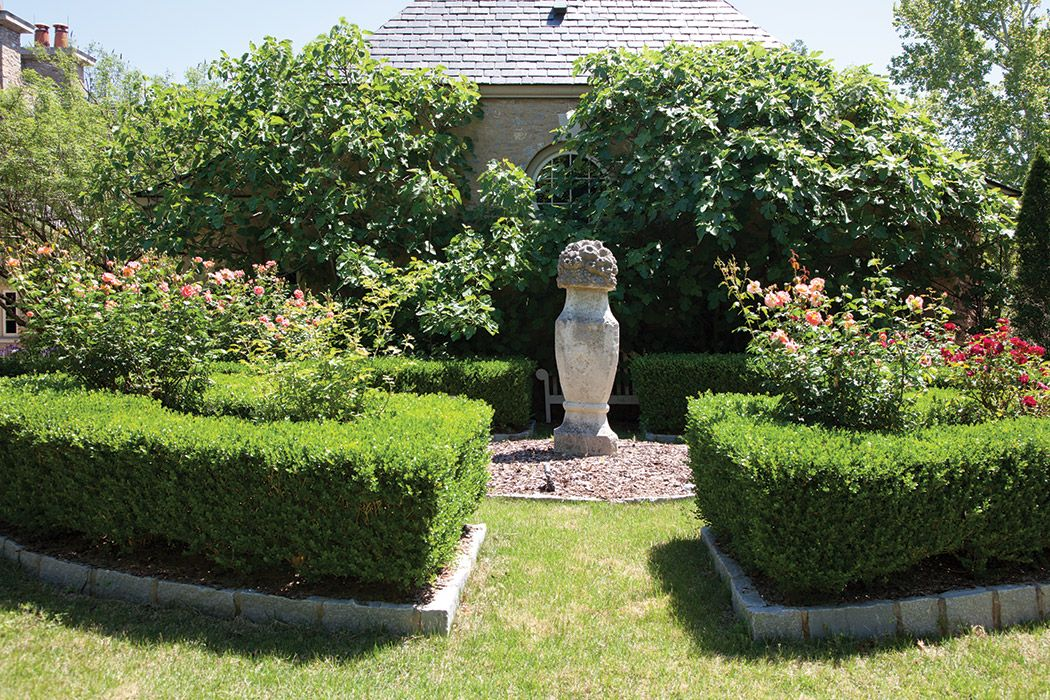 Korean boxwoods define a knot garden, accented by a 200-year-old ...