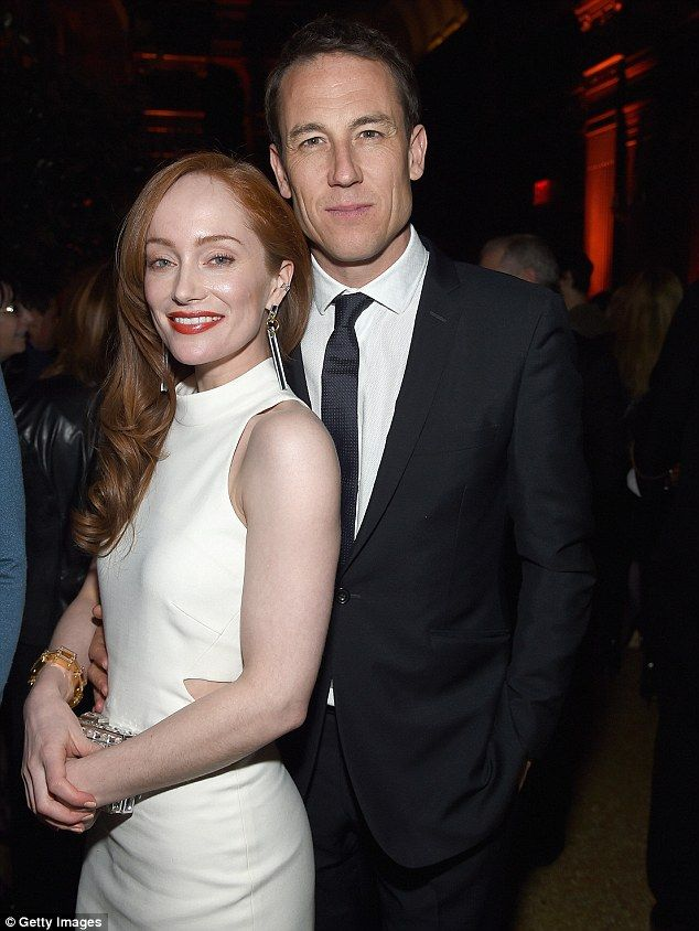 Suited and booted: Lotte Verbeek kept close to a suave looking Tobias Menzies inside ...