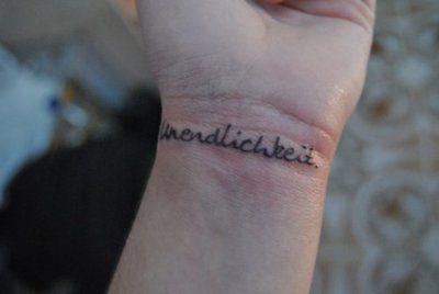 unendlichkeit means infinite in german, tattoo