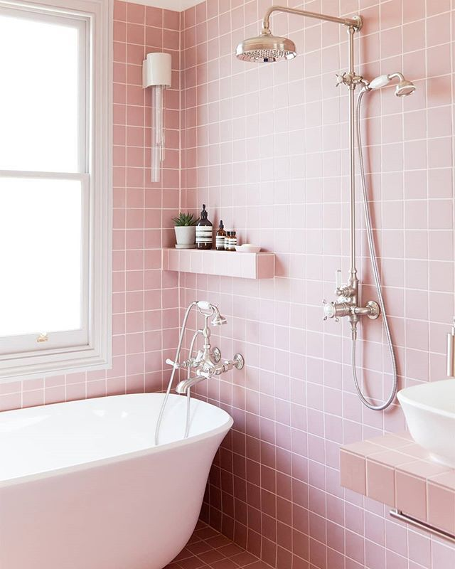 All Over Pink Tiles Says 80s But White Details Down To The Grout Keep The Bathroom Feeling Light In 2020 Colorful Bathroom Tile Pink Bathroom Tiles Pink Bathroom