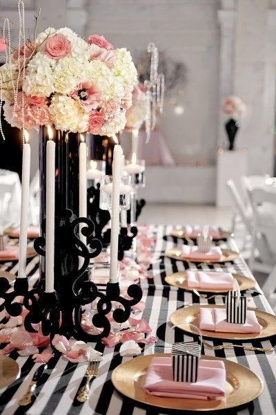 Black and white tables cape with little touches of pink I shower - pink black and white weddings