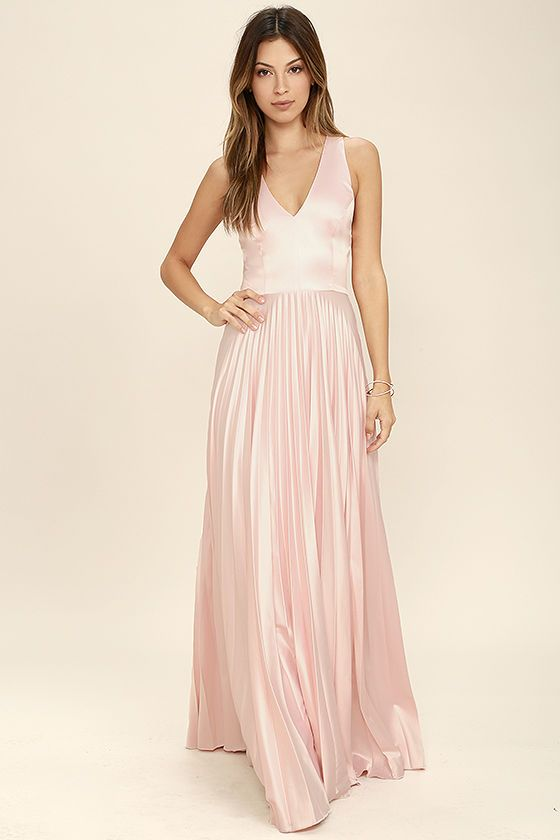 Whatever the occasion, make the most of it in the Epic Night Blush Pink Satin Maxi Dress! Elegant satin, in a lovely pink hue, shapes a sleeveless, princess-seamed bodice with V-neckline. A tying back supports wide draping straps atop a fitted waist, and accordion pleated maxi skirt. Hidden back zipper and clasp.