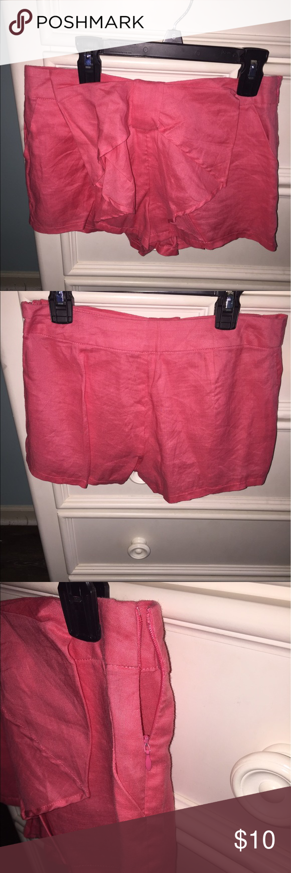 Shorts Coral colored shorts. Has bow on the front. Two pockets on front. Zipper on the side. The material of these shorts is linen. Fashionomics Shorts