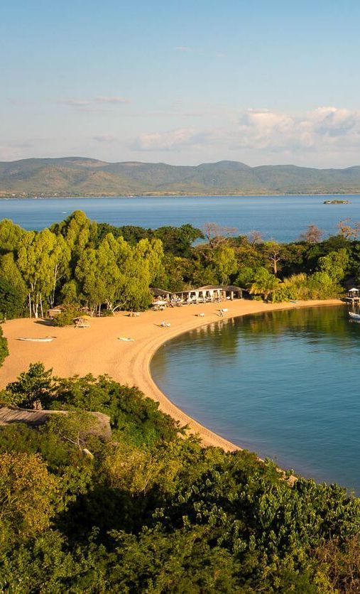 May is a prime month to visit Lake Malawi, a freshwater paradise between Malawi and Mozambique. Timbuktu Travel.