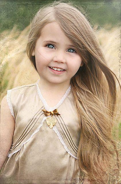 She looks like a doll from American girl