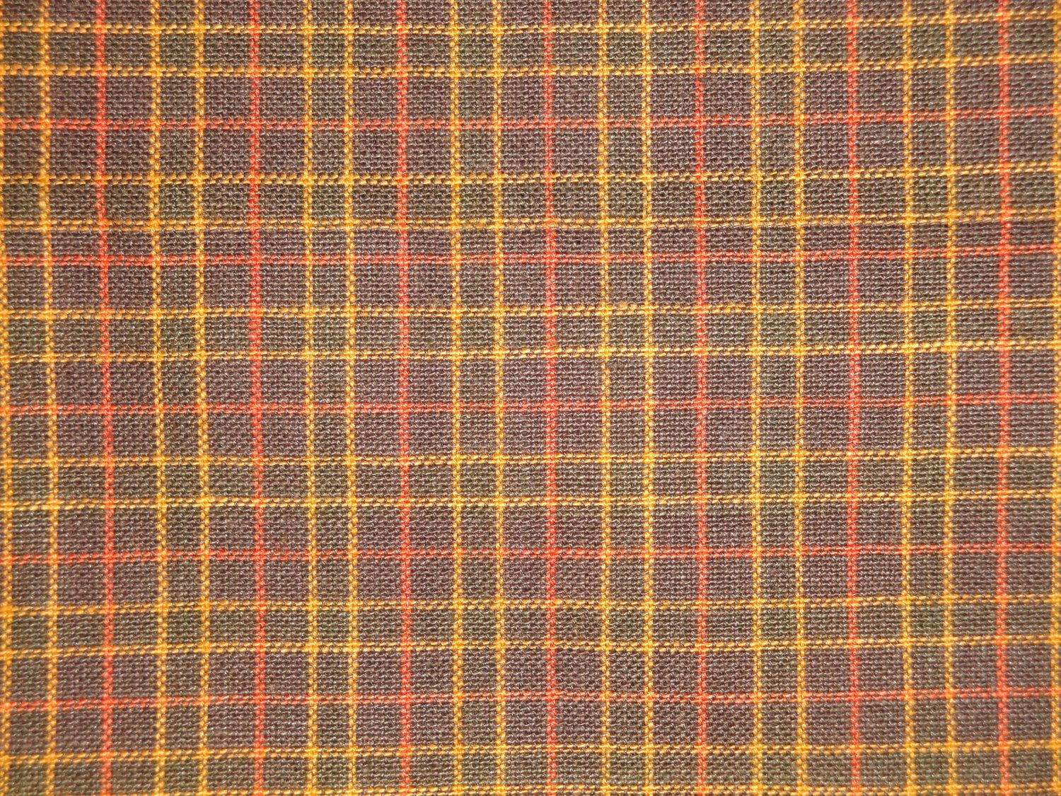 Window Pane Plaid material. 100% Cotton. Hand wash separately. No chlorine bleach. Line dry. Bolt end reads brown and rust window pane plaid.  Listing is for 1 yard 36 inches long x 44 inches wide.  If ordering more that 1 it will come in one continuous piece.  Last photo shows