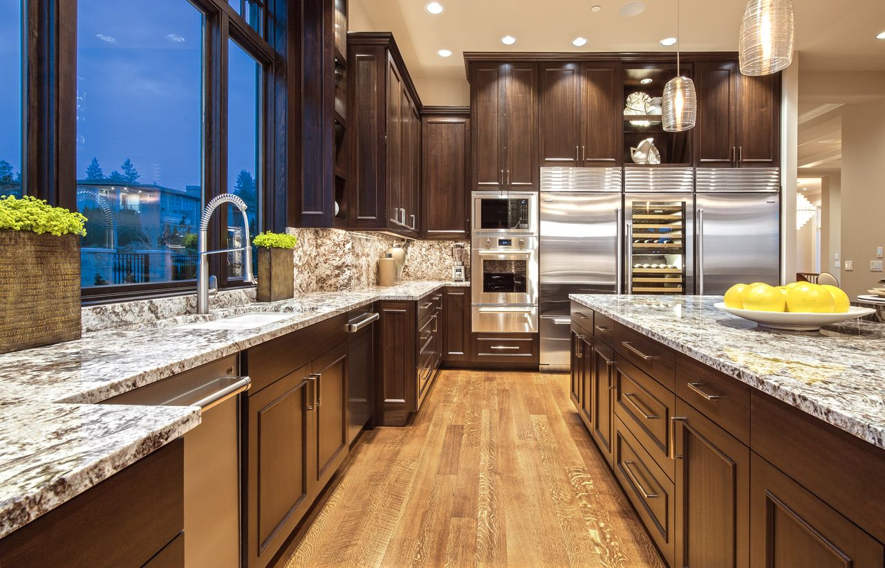 Chocolate Brown Cabinets And Granite Brown White Countertops Are The Perfect Du Stone Countertops Kitchen White Granite Countertops Cost Of Granite Countertops