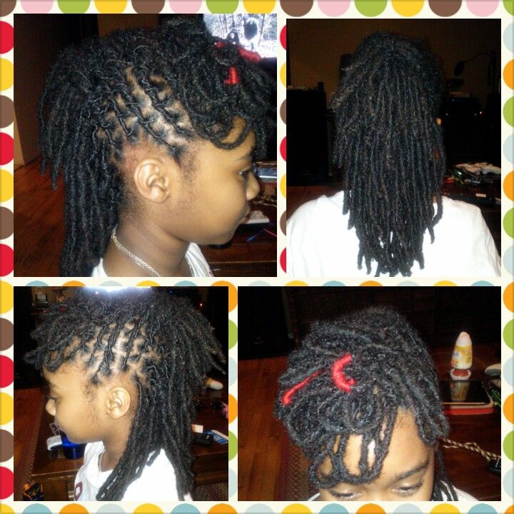 No pins, clips, heat or added hair.. Child style! Ten year old girl with three year old locs, we change the yarn in her hair every month. This was February.