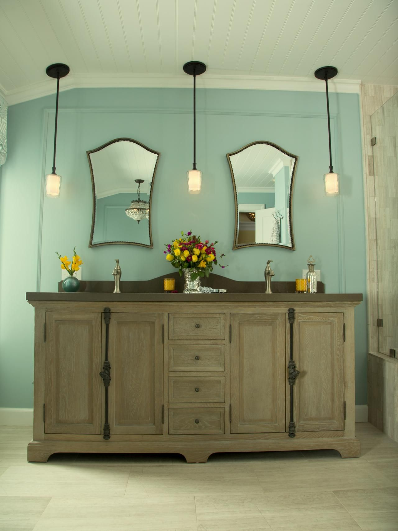 Vintage-style pendants, a beadboard ceiling and a weathered ...