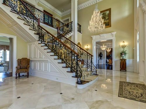 Staircase and chandelier inside a mansion in Tennessee.