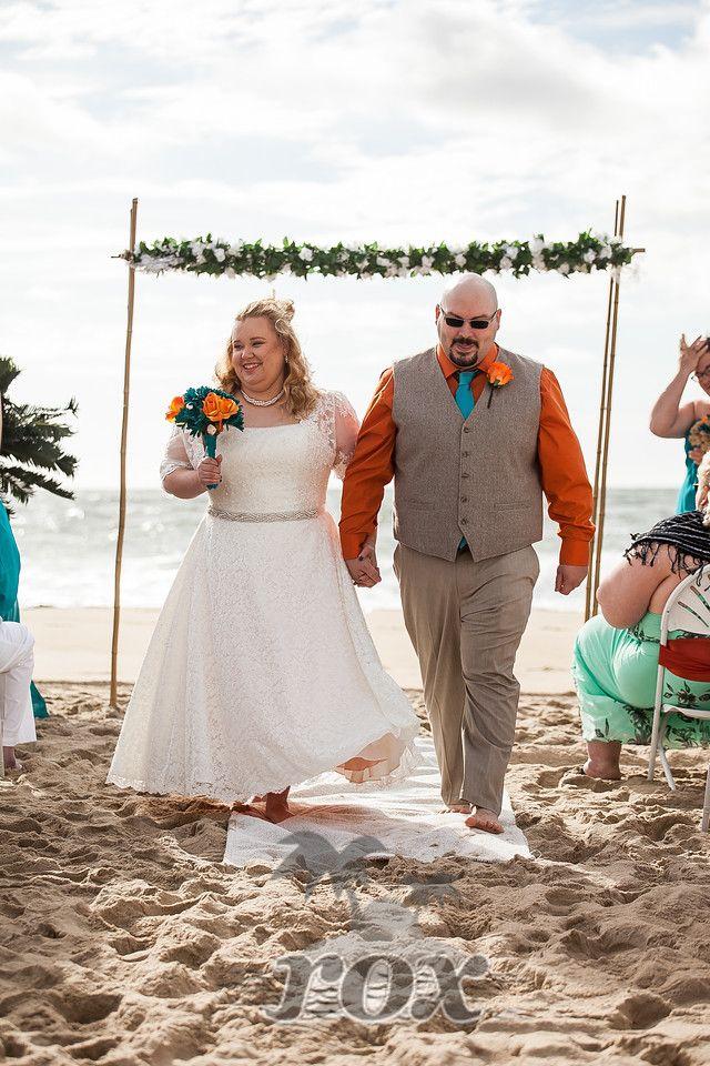 Beach wedding recessional on the Ocean City, MD sand: https://www.roxbeachweddings.com/