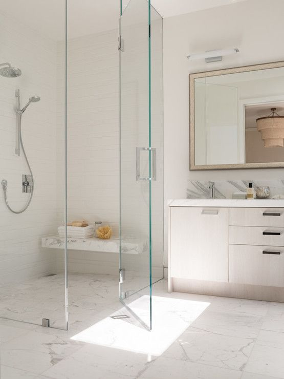 Sleek Bathroom Features Seamless Glass Shower Accented With White