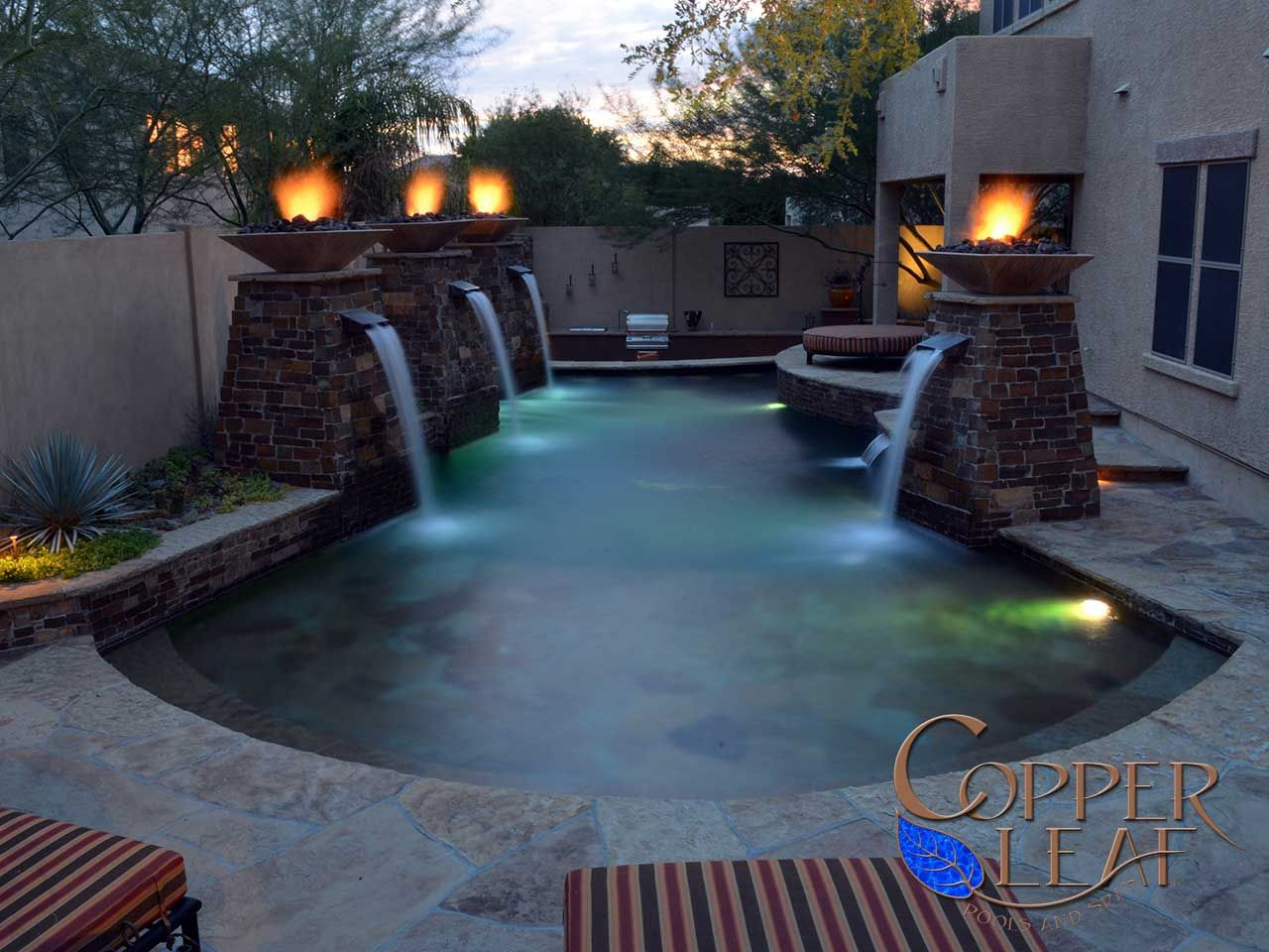 Fire and water geometric pool with flagstone step for Pool fire bowls