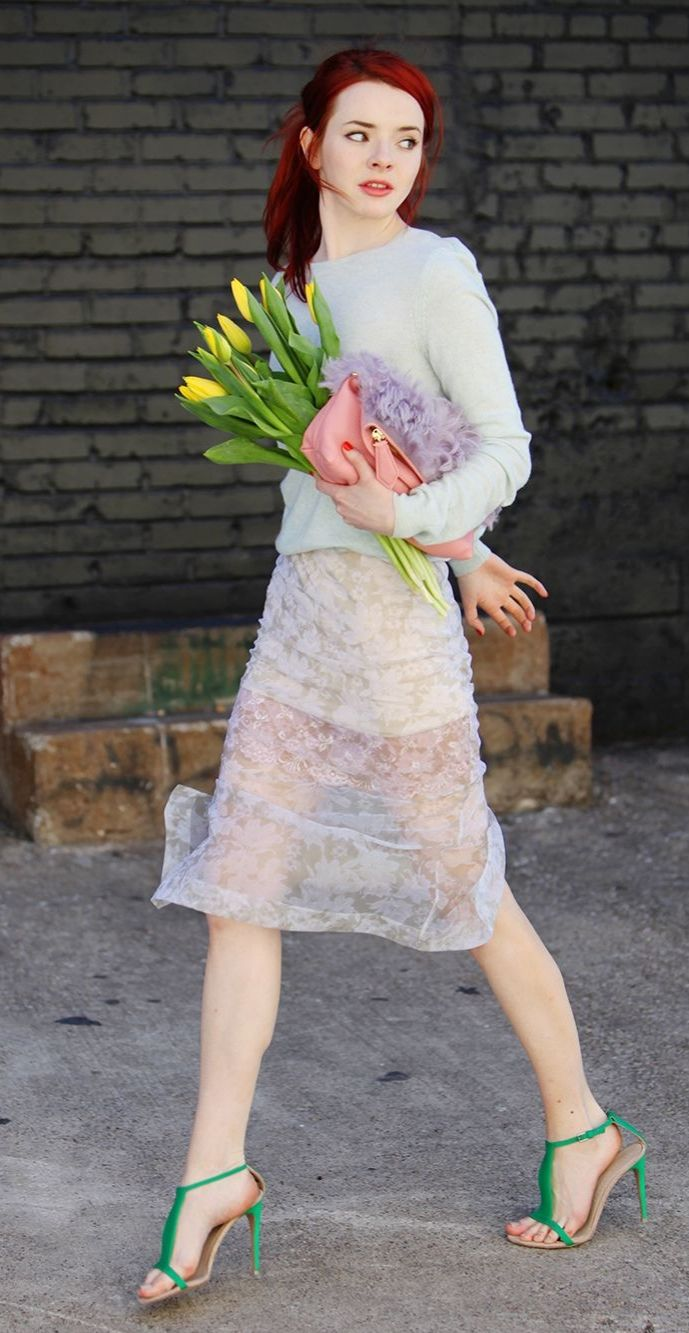 Jane Aldridge of Sea of Shoes in a lovely spring outfit with punchy green heels.