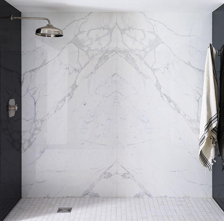 statuario venato bookmatched and nero absolute polished granite
