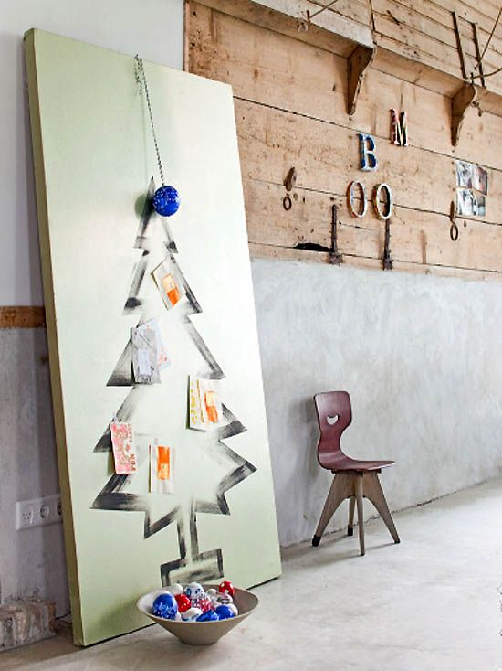 Giant canvas with painted Christmas Tree. Add velcro dots to tree and ornaments and get the kids to decorate it!