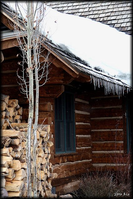 cabin in the snow~beautifully stacked wood