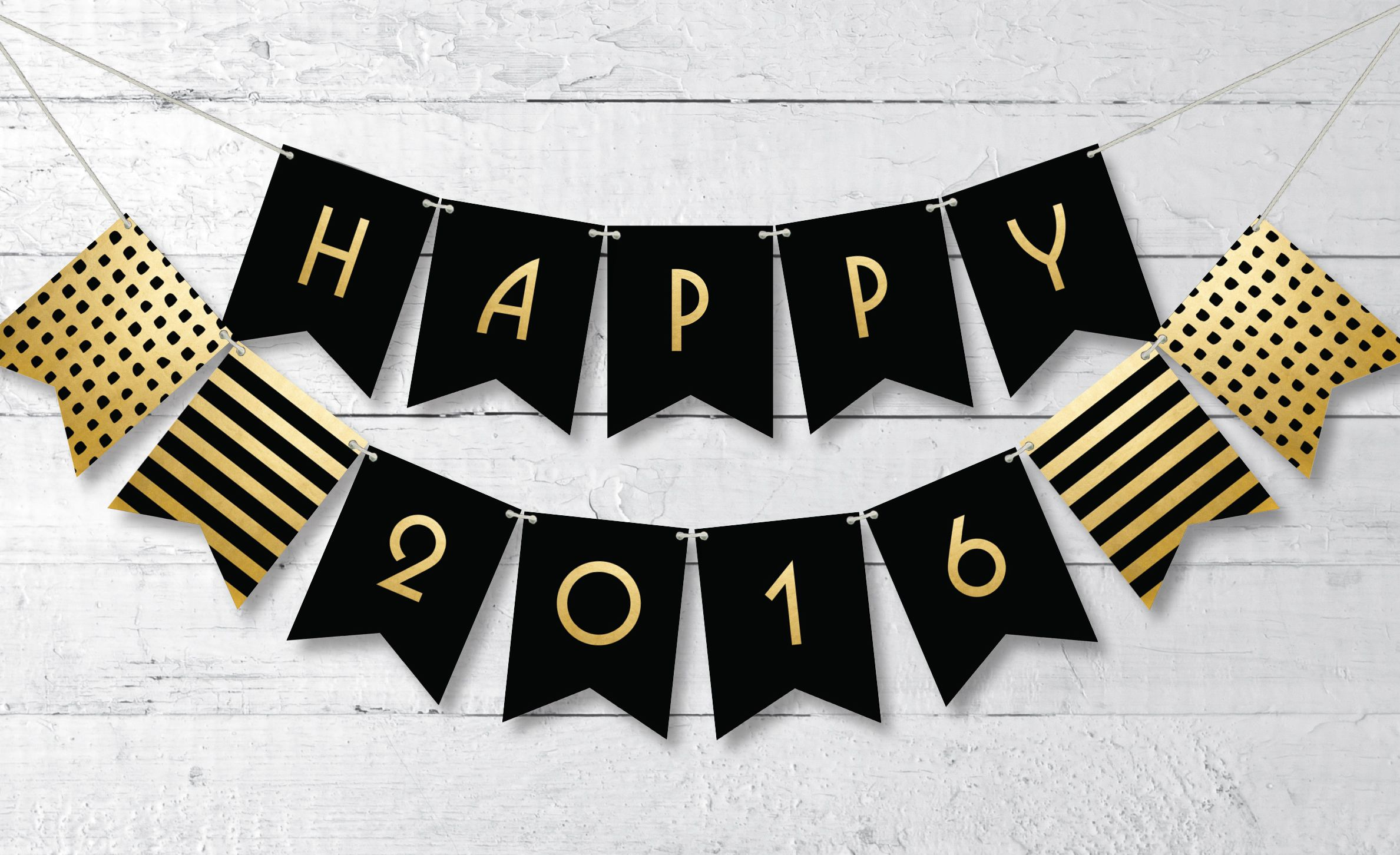 celebrate new years eve in a classy way with this free printable happy 2016 banner in black and gold