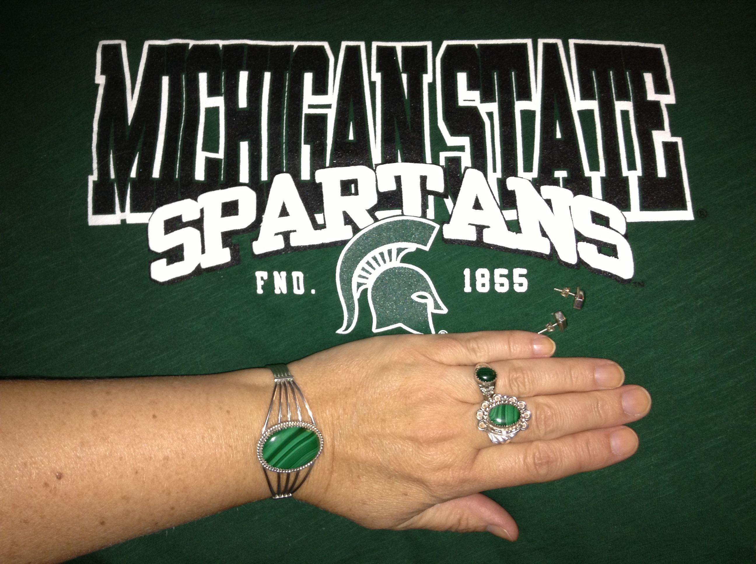 on crew state stadium best college turf spartan rings touches field sports puts michigan finishing s story football msu nation