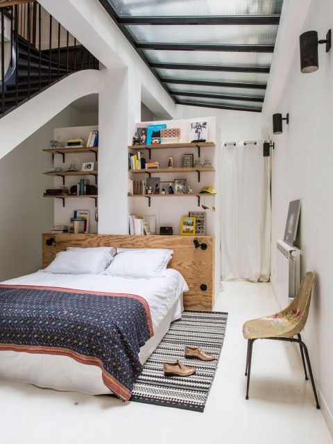 Built-in headboard and shelving in the bedroom of French stylist Anne-Fleur Broudehoux. Photo - Louise Desrosiers. Shared with kind permission from Milk Magazine.
