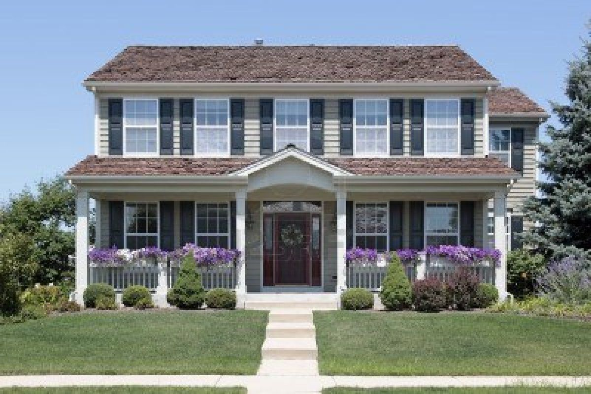 Suburban home with blue shutters and front porch