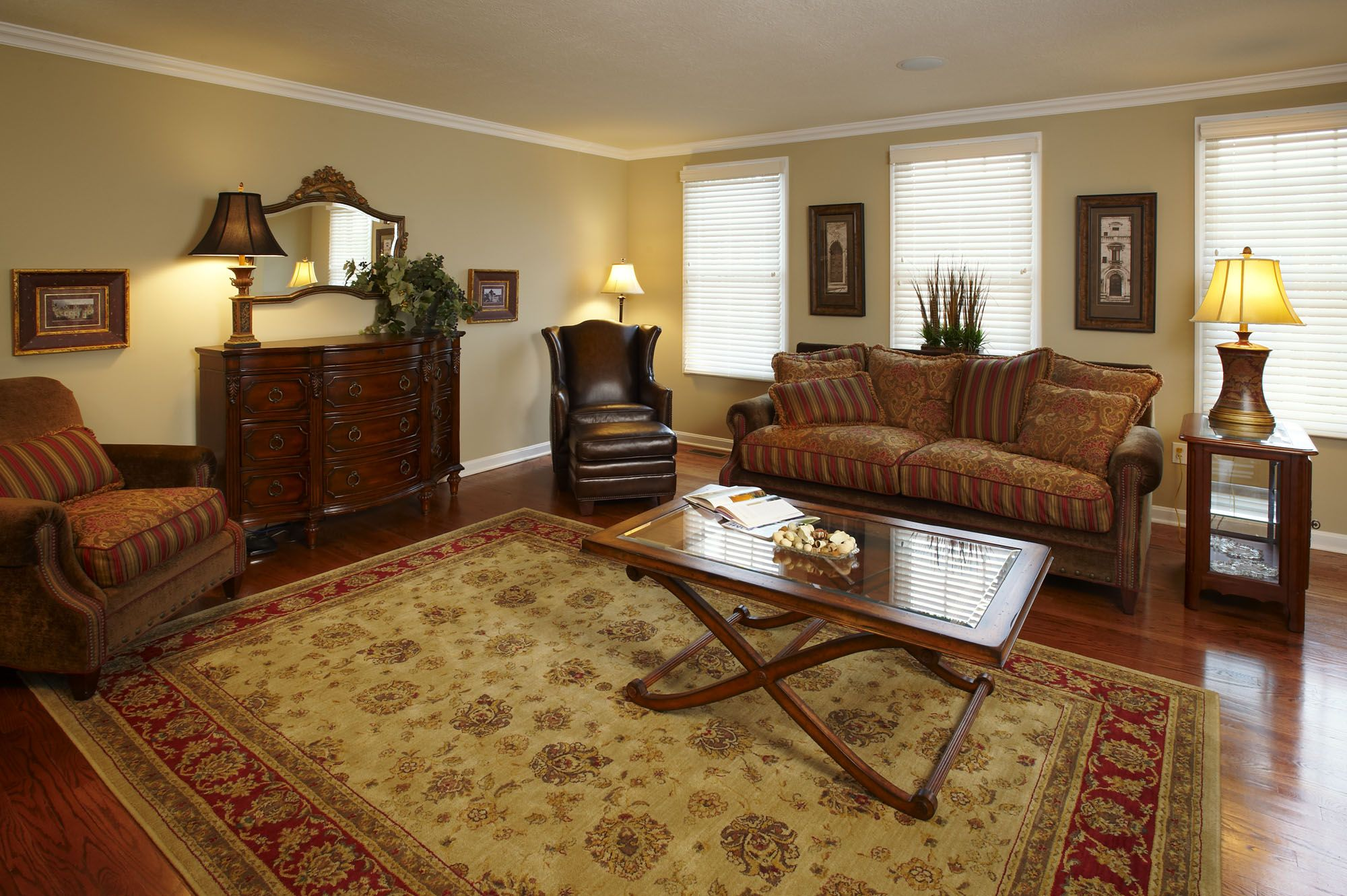 Living room with hardwood floors persian rug and cherry