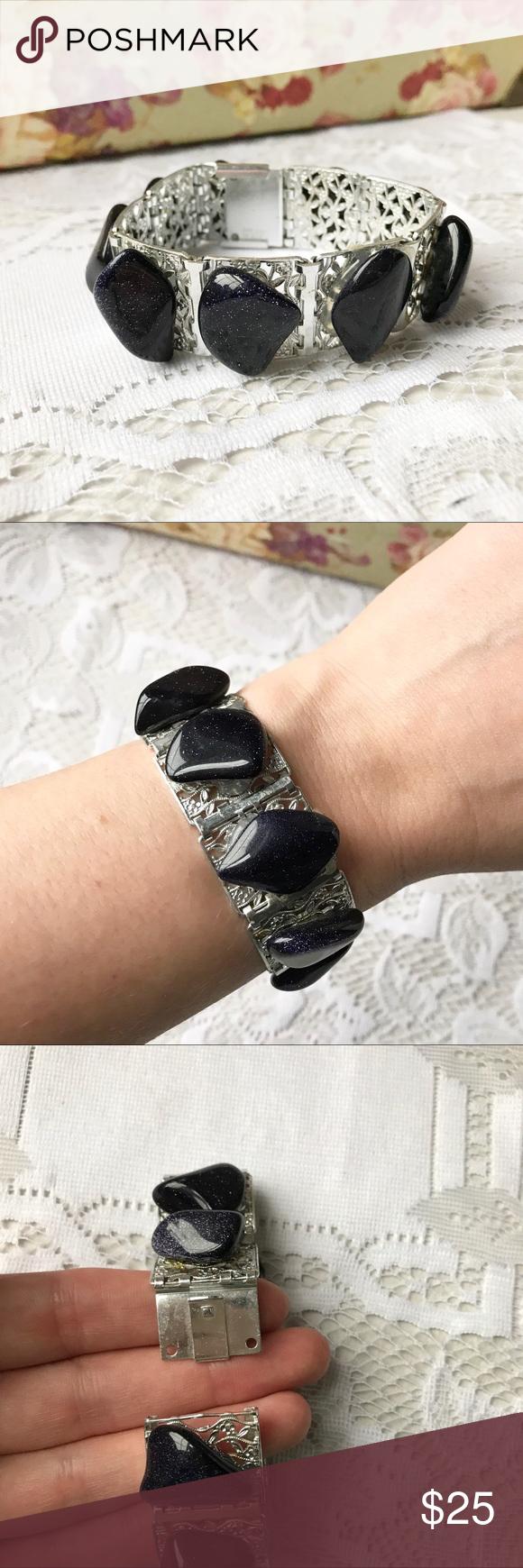 Purple Stone Bracelet Beautiful silver tone bracelet with shimmering deep purple stones. Jewelry Bracelets