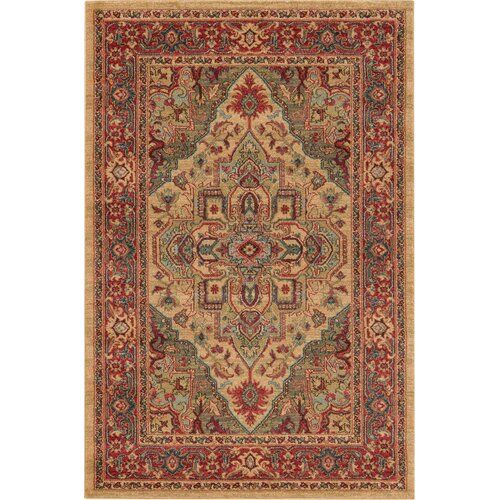 Home Loft Concept Bring a touch of traditional style and plenty of flair to your home with this area rug. It features striking geometric patterns in red and beige that are reminiscent of Persian textile design. This rug is stain resistant and suitable for use with underfloor heating. A rug gripper is recommended. Rug Size: Rectangle 120 x 170cm
