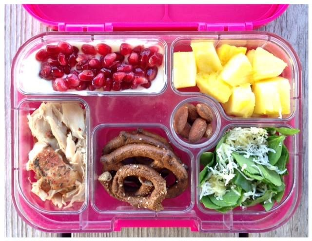This is what my 7-year-old got for lunch today: Leftover slow cooker chicken, whole-wheat pretzels, spinach salad, pineapple, plain yogurt with a little pure maple syrup and pomegranate seeds, and roasted almonds. We used our Yumbox today.