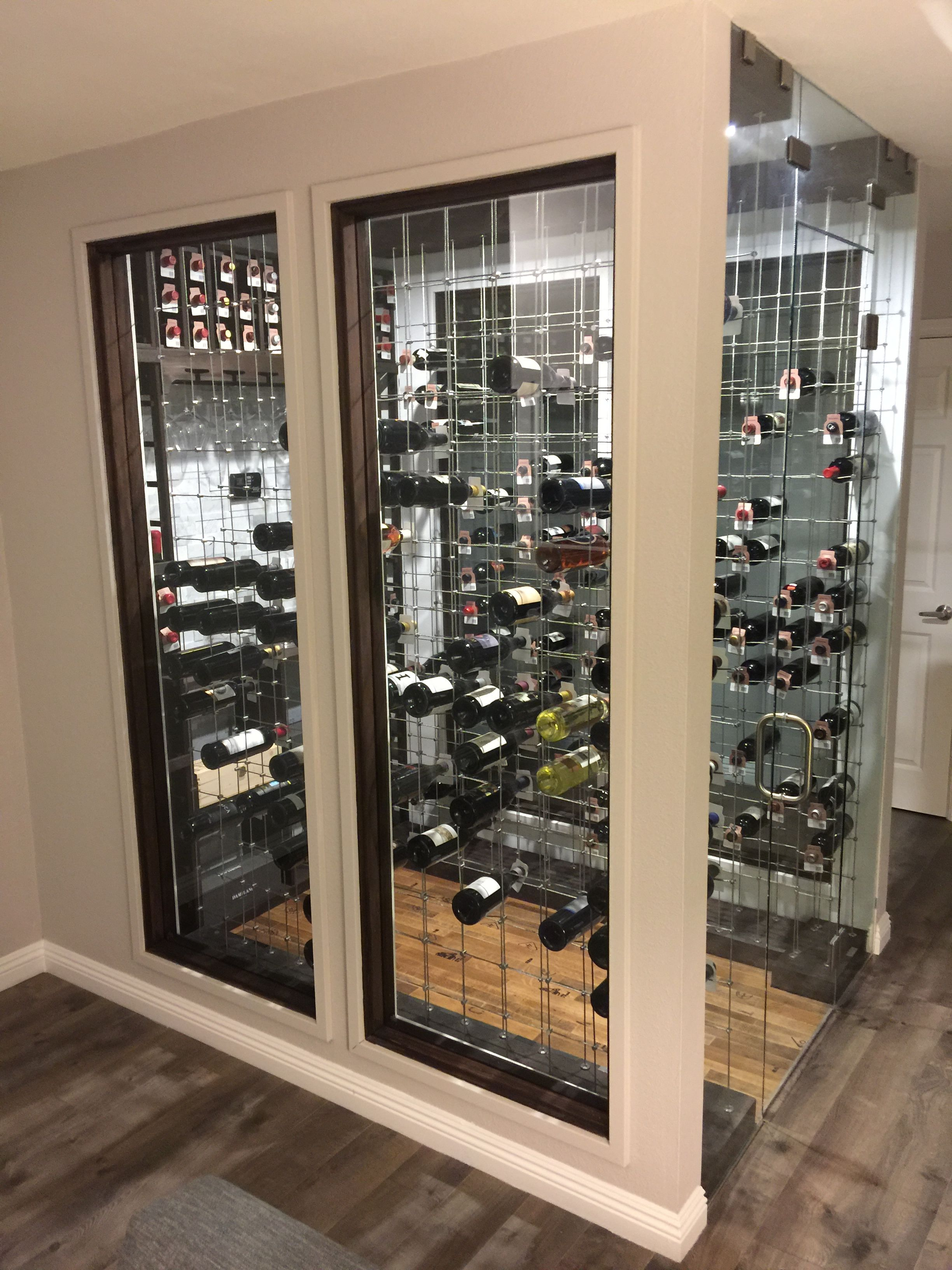Wine Cellar Or Room With Cable Racking Walnut Racks Carrara Marble Wall Gl Doors And Cooling System