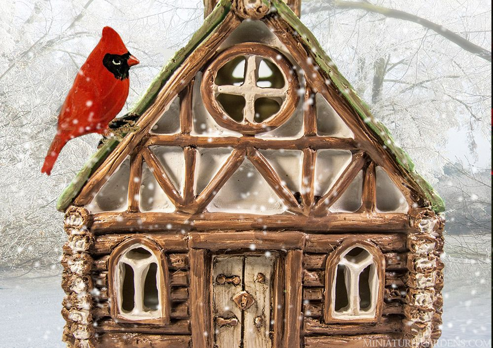 Mini Fairy Church with cardinal and falling snow in the fairy garden.
