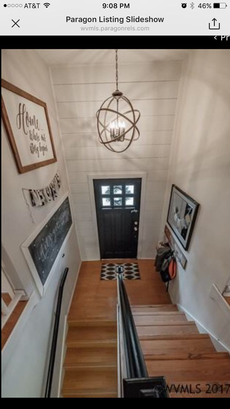 Split level foyer with white walls shiplap