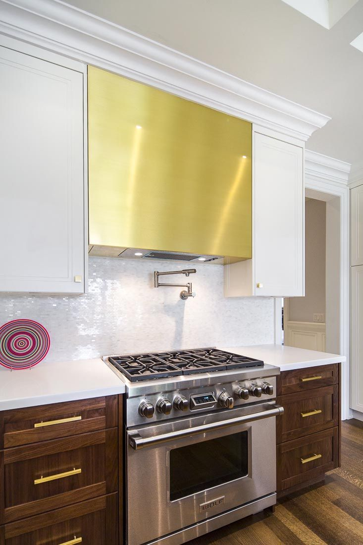 Modern Spacious Kitchen Brass Range Hood And Cabinetry Hardware Spacious Kitchens Cabinetry Hardware Dining Design