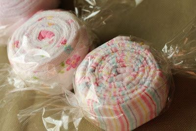 """Have you noticed all the cute things that can be made with baby supplies…like cakes made of diapers and stuff like that? I decided to make some """"candies"""" made of burp cloths for a neighbor friend who just had a baby."""