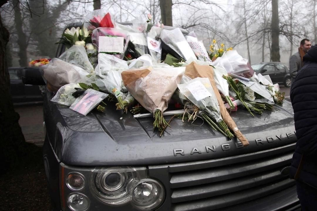 After the death of George the  Range Rover full of flowers