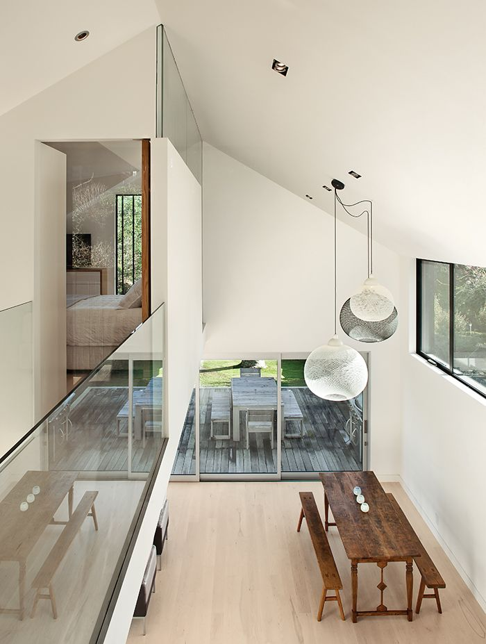 New Zealand Home Has Double Height Ceiling With Moooi Pendant Lamps Above The Dining Area Split