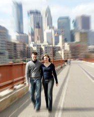 Engagement photo of Erik and Monica on the Stone Arch Bridge.
