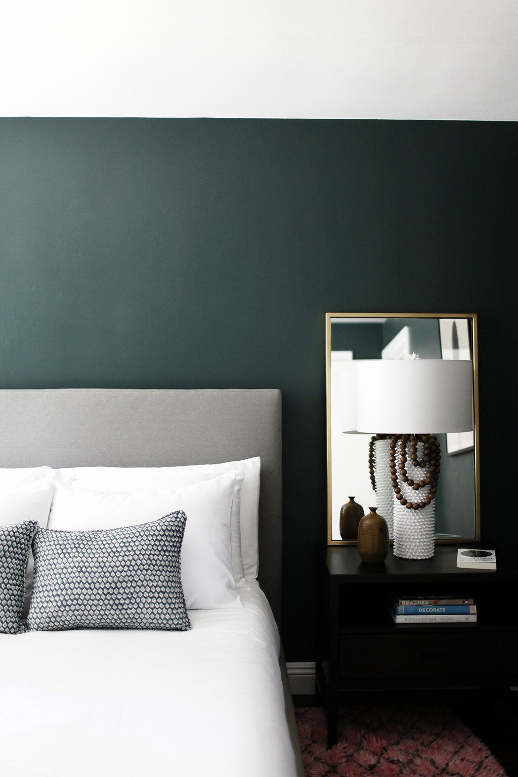 minimalist bedroom with dark green walls - gorgeous!! paint color