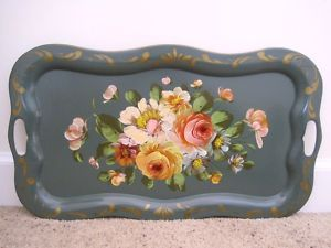 I like how these old trays are coming back for side tables. Seen lots of these at flea markets!