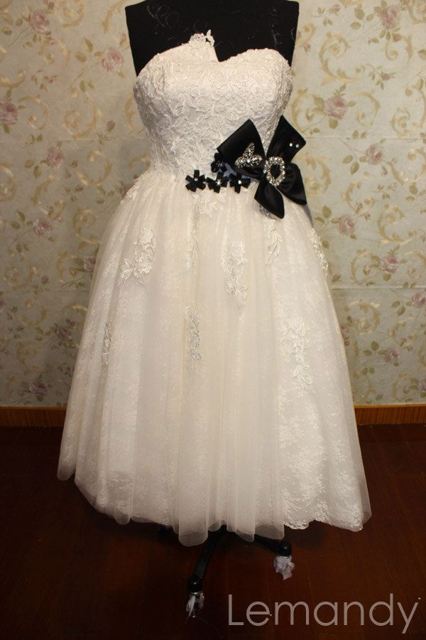 strapless Tea-length princess tulle wedding dress with black bow. $205.00, via Etsy.