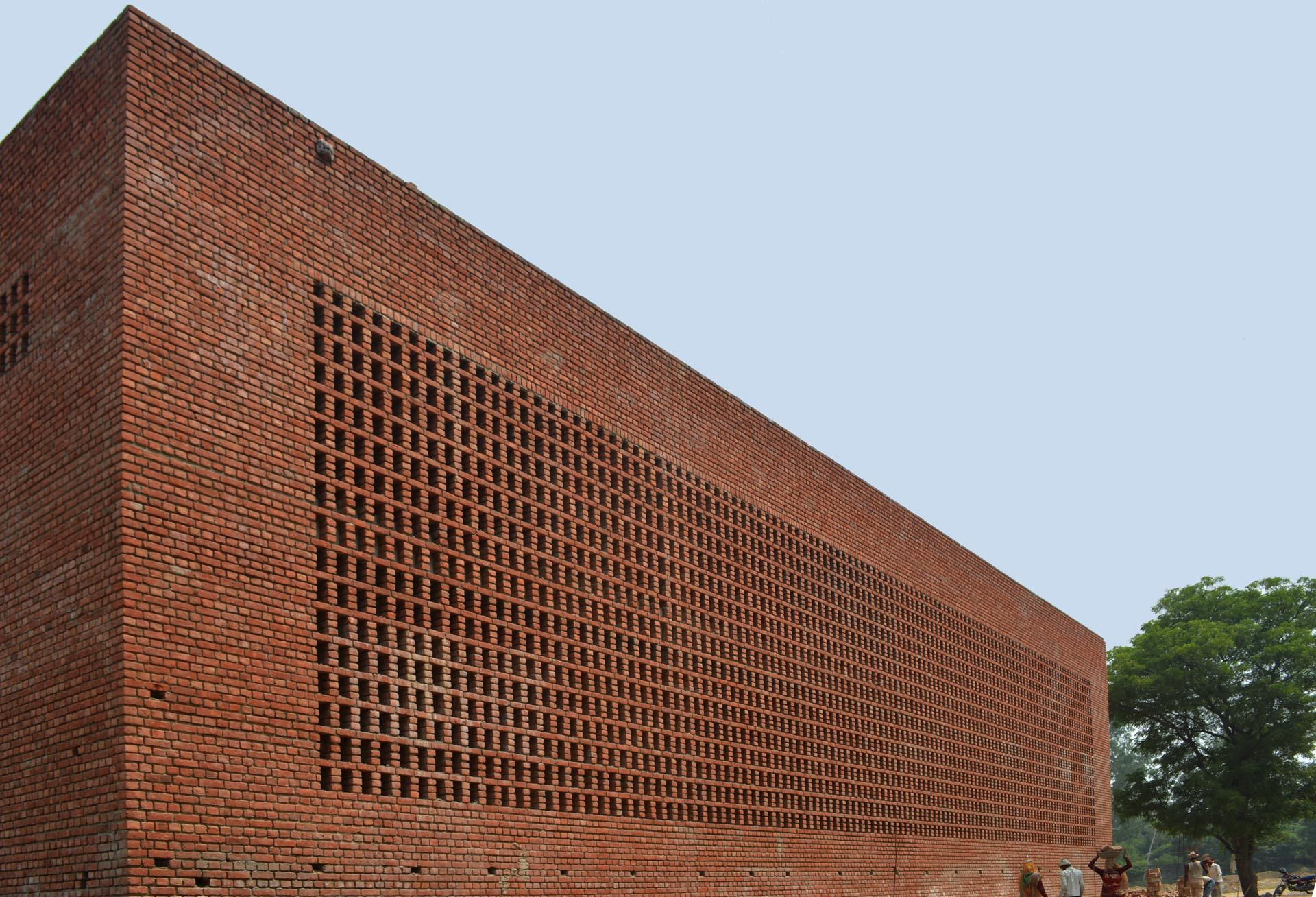 The warehouse and the loading bay feature an outer fa ade for Perforated brick wall