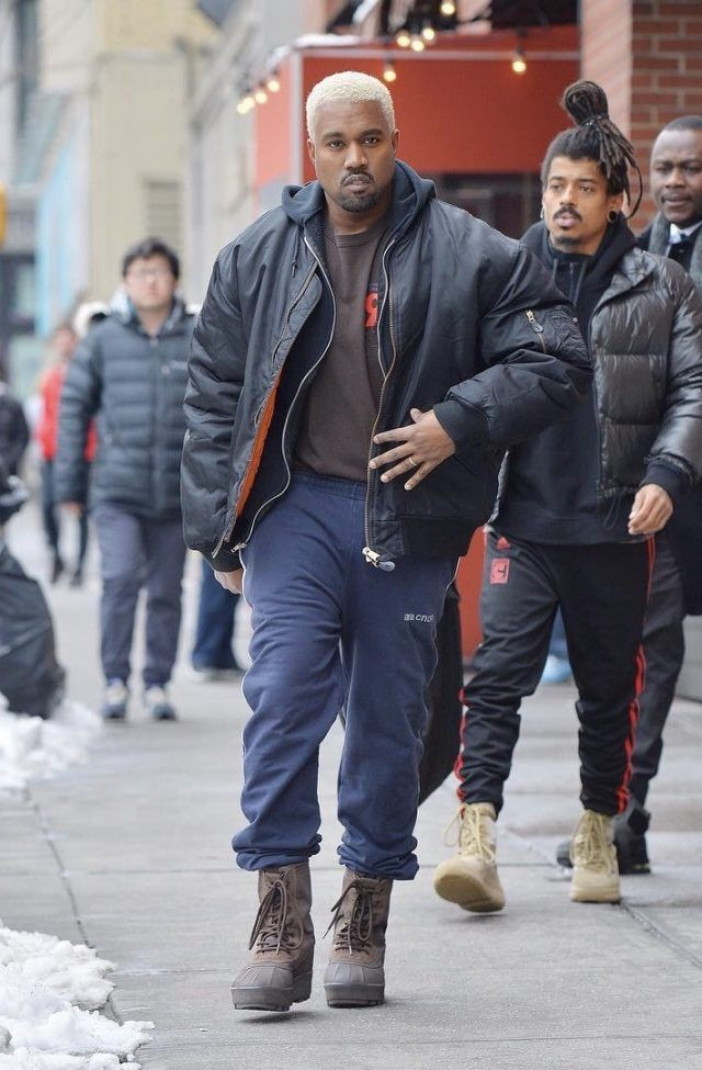 Kanye West Wears Raf Simons Jacket Gosha Rubchinskiy Sweatpants And Yeezy Season 950 Boots In Nyc Upscal Kanye West Outfits Kanye West Style Military Outfit