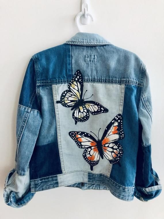 This is a thrifted Gap Kids patchwork denim jacket in a size L (10/11). I hand painted two butterflies on the back, added a rose patch and brass studs in the front. Due to the delicate nature of this item, I recommend hand/spot washing.