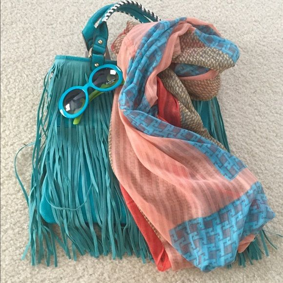 Fringe Bags Aqua  Fringe Bags. Bag has silver threading in handles. Bag has an attachable cross body strap. Scarves sold separately- $15.00. Faux suede. COS Bags
